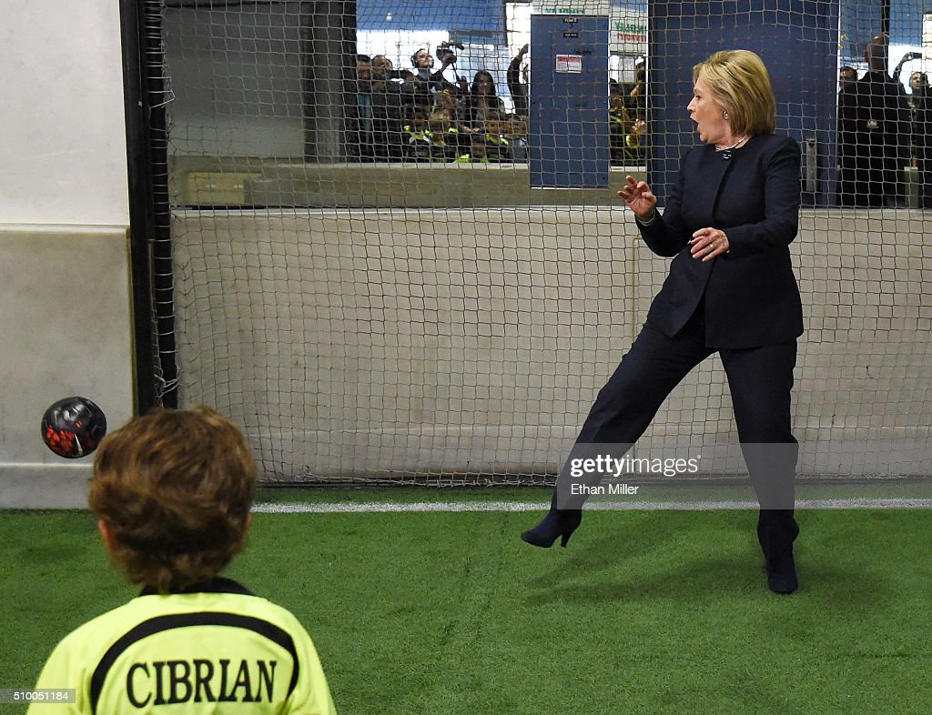 Democratic presidential candidate <a gi-track='captionPersonalityLinkClicked' href=/galleries/search?phrase=Hillary+Clinton&family=editorial&specificpeople=76480 ng-click='$event.stopPropagation()'>Hillary Clinton</a> reacts as a shot from a youth soccer player goes wide of the goal as she plays goaltender at the Las Vegas Indoor Sports Center on February 13, 2016 in Las Vegas, Nevada. Clinton is challenging Sen. Bernie Sanders for the Democratic presidential nomination ahead of Nevada's Feb. 20 Democratic caucus.