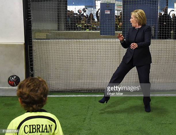 Democratic presidential candidate Hillary Clinton reacts as a shot from a youth soccer player goes wide of the goal as she plays goaltender at the...