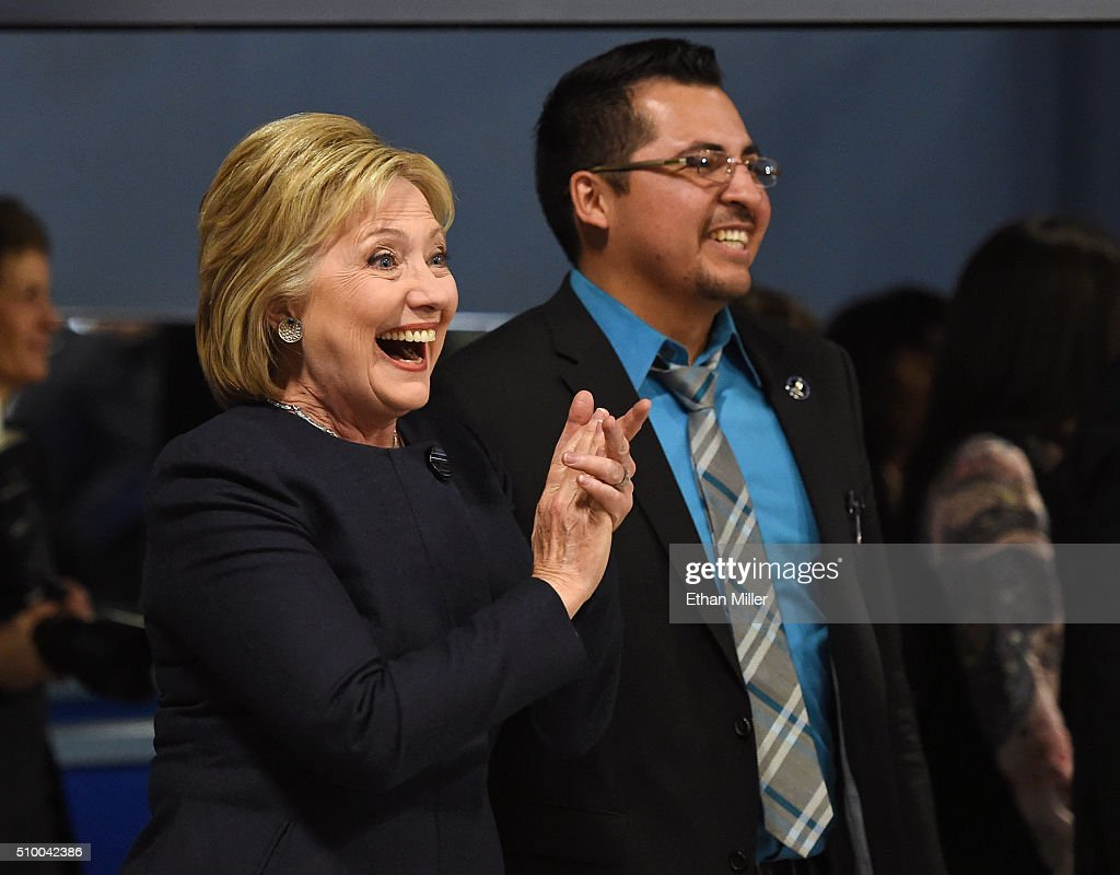 Democratic presidential candidate <a gi-track='captionPersonalityLinkClicked' href=/galleries/search?phrase=Hillary+Clinton&family=editorial&specificpeople=76480 ng-click='$event.stopPropagation()'>Hillary Clinton</a> (L) reacts as she visits the Las Vegas Indoor Sports Center with Nevada State Assemblman Edgar Flores (D-NV) on February 13, 2016 in Las Vegas, Nevada. Clinton is challenging Sen. Bernie Sanders for the Democratic presidential nomination ahead of Nevada's Feb. 20 Democratic caucus.
