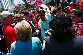 US Democratic presidential candidate Hillary Clinton shakes hands with Members of the Atlantic City casino workers union members outside the Taj...