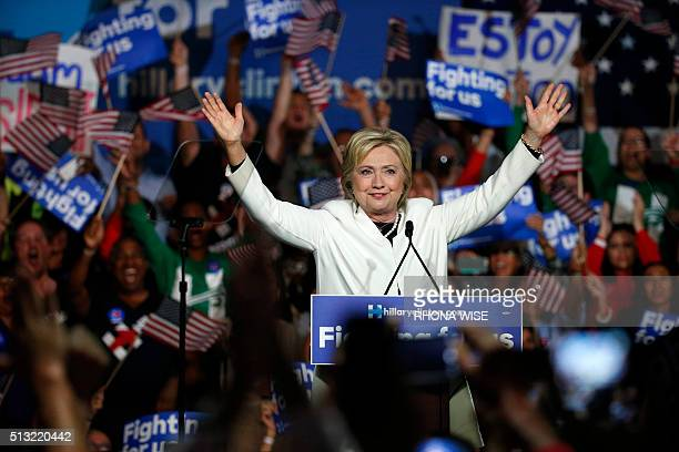 Democratic presidential candidate Hillary Clinton speaks at a rally during a campaign event on Super Tuesday in Miami on March 1 2016 / AFP / RHONA...
