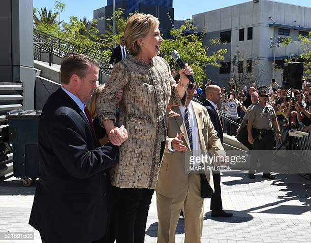 US Democratic Presidential candidate Hillary Clinton speaks to the overflow crowd who were unable to get into the venue during a campaign rally at...