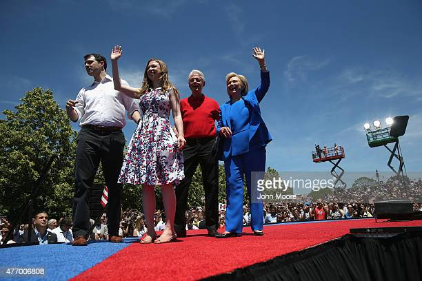 Democratic Presidential candidate Hillary Clinton stands with former President Bill Clinton their daughter Chelsea Clinton and her husband Marc...