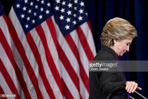 Democratic presidential candidate Hillary Clinton steps down a staircase after making a concession speech following her defeat to Republican...