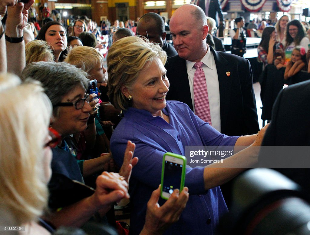 Democratic Presidential candidate Hillary Clinton take selfies with campaign supporters after her speech at campaign rally at the Cincinnati Museum Center at Union Terminal June 27, 2016, in Cincinnati, Ohio. Senator Elizabeth Warren is helping Clinton campaign in Ohio.