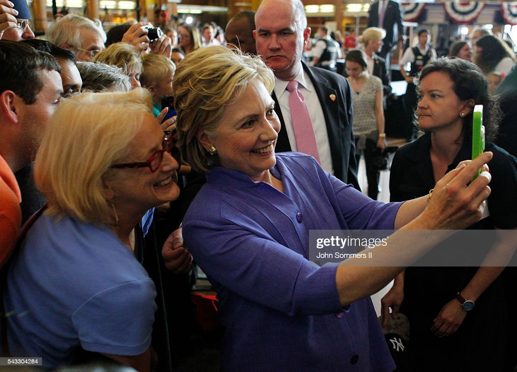Democratic Presidential candidate <a gi-track='captionPersonalityLinkClicked' href=/galleries/search?phrase=Hillary+Clinton&family=editorial&specificpeople=76480 ng-click='$event.stopPropagation()'>Hillary Clinton</a> take selfies with campaign supporters after her speech at campaign rally at the Cincinnati Museum Center at Union Terminal June 27, 2016, in Cincinnati, Ohio. Senator Elizabeth Warren is helping Clinton campaign in Ohio.