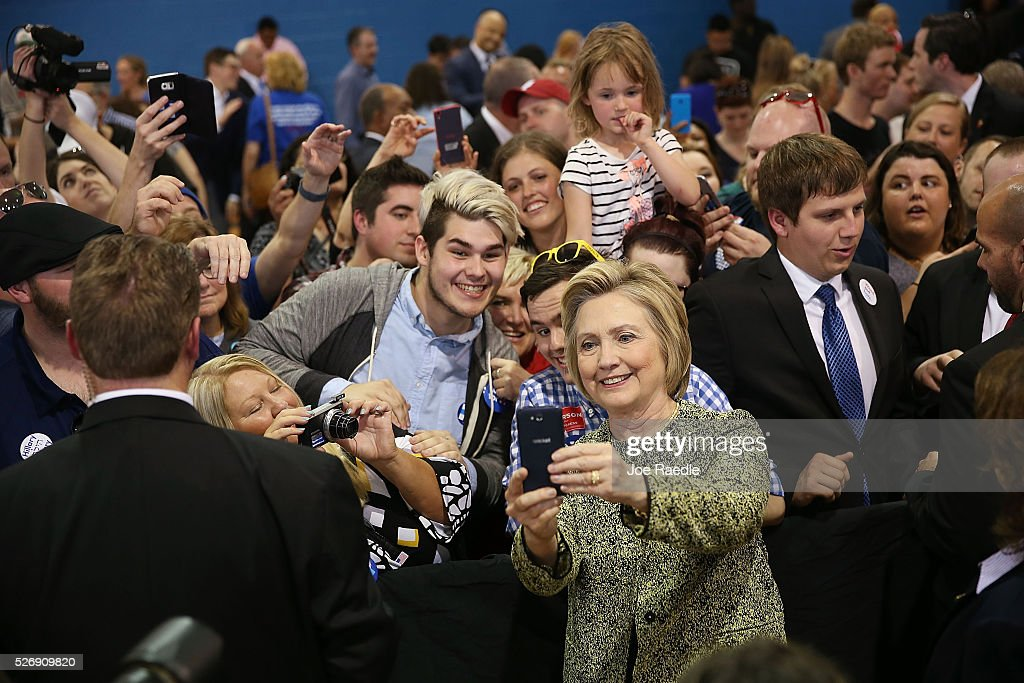 Democratic presidential candidate <a gi-track='captionPersonalityLinkClicked' href=/galleries/search?phrase=Hillary+Clinton&family=editorial&specificpeople=76480 ng-click='$event.stopPropagation()'>Hillary Clinton</a> takes cell phone photographs with people during a campaign stop at the Douglass Park Gynasium on May 1, 2016 in Indianapolis, Indiana. Presidential candidates continue to campaign across the state leading up to Indiana's primary day on May 3.