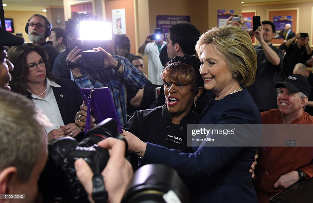 Democratic presidential candidate <a gi-track='captionPersonalityLinkClicked' href=/galleries/search?phrase=Hillary+Clinton&family=editorial&specificpeople=76480 ng-click='$event.stopPropagation()'>Hillary Clinton</a> (2nd R) takes photos with workers during a visit to employee dining room at Harrah's Las Vegas on February 13, 2016 in Las Vegas, Nevada. Clinton is challenging Sen. Bernie Sanders for the Democratic presidential nomination ahead of Nevada's Feb. 20 Democratic caucus.
