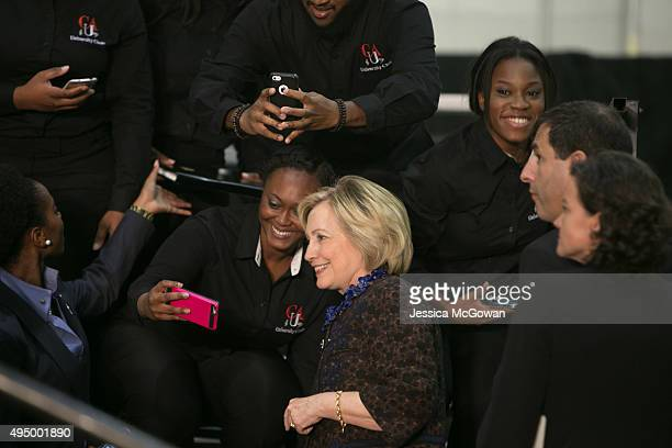 Democratic presidential candidate Hillary Clinton takes selfies with students in the crowd gathered during an ''African Americans For Hillary'' rally...