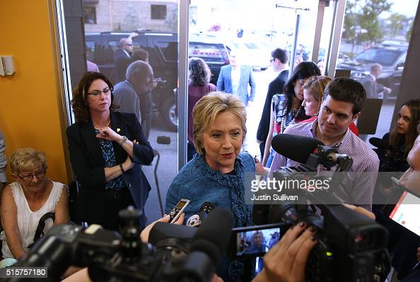 Democratic presidential candidate Hillary Clinton talks to members of the media during a visit to a Dunkin' Donuts on March 15 2016 in West Palm...