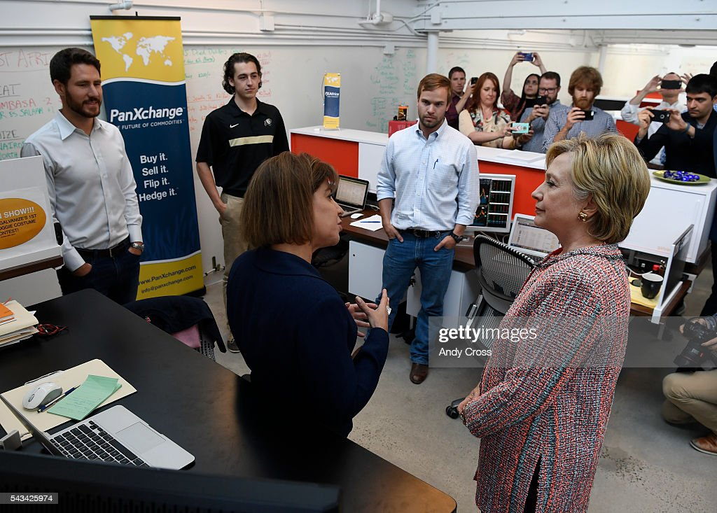 Democratic Presidential candidate Hillary Clinton talks with PanXchange CEO Julie Lerner, left, during a campaign stop at Galvanize June 28, 2016.