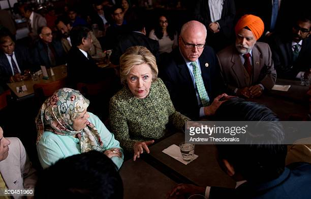 Democratic presidential candidate Hillary Clinton talks with patrons as she visits the Jackson Diner on April 11 2016 in the Flushing neighborhood of...
