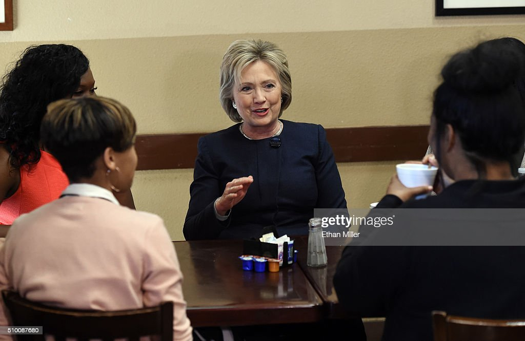 Democratic presidential candidate <a gi-track='captionPersonalityLinkClicked' href=/galleries/search?phrase=Hillary+Clinton&family=editorial&specificpeople=76480 ng-click='$event.stopPropagation()'>Hillary Clinton</a> (C) talks with people as she visits the Gritz Cafe on February 13, 2016 in Las Vegas, Nevada. Clinton is challenging Sen. Bernie Sanders for the Democratic presidential nomination ahead of Nevada's Feb. 20 Democratic caucus.