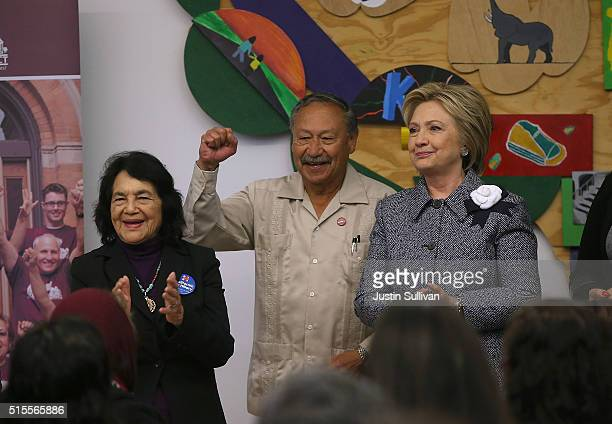 Democratic presidential candidate Hillary Clinton United Farm Workers of America Arturo Rodriguez and Dolores Huerta greet residents attending an...