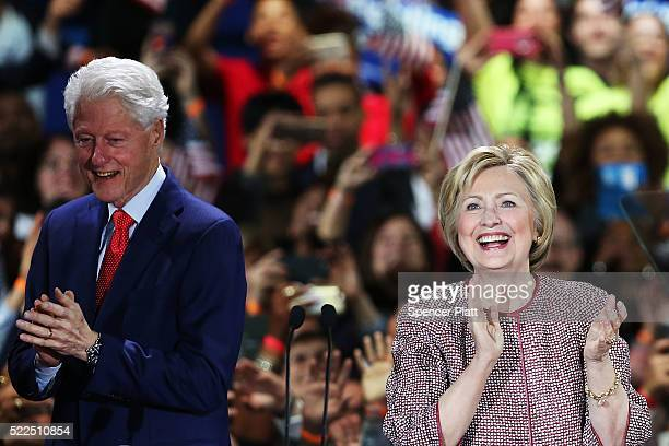Democratic presidential candidate Hillary Clinton walks on stage with her husband Bill Clinton after winning the highly contested New York primary on...