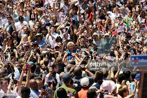 Democratic Presidential candidate Hillary Clinton walks onto stage to speak at her official kickoff rally at the Four Freedoms Park on Roosevelt...