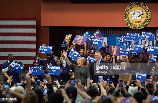 STATES FEB 29 Democratic presidential candidate Hillary Clinton waves alongside Virginia Gov Terry McAuliffe at an event at George Mason University...