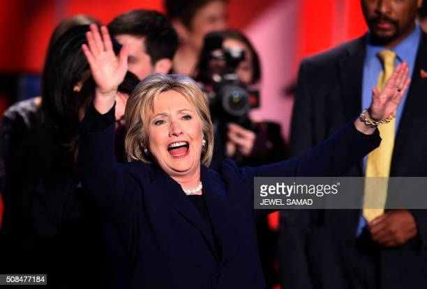 US Democratic presidential candidate Hillary Clinton waves to the audience after participating in the MSNBC Democratic Candidates Debate with Bernie...