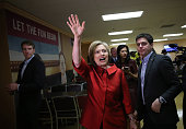 Democratic presidential candidate Hillary Clinton waves to workers inside the employee dining room at Harrah's Las Vegas on February 20 2016 in Las...