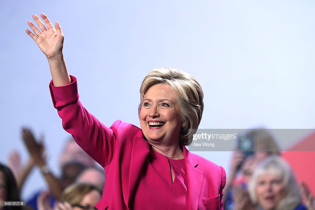 Democratic presidential candidate Hillary Rodham Clinton waves after she addressed the 95th Representative Assembly of the National Education Association July 5, 2016 in Washington, DC. Clinton will be joined by President Barack Obama at a campaign stop in Charlotte, North Carolina later today.