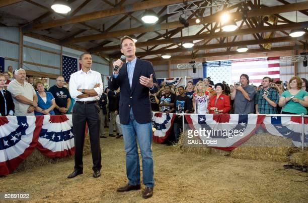 US Democratic presidential candidate Illinois Senator Barack Obama listens as Indiana Senator Evan Bayh introduces him during a town hall meeting at...