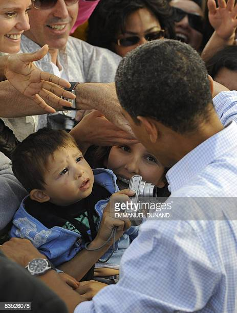 US Democratic presidential candidate Illinois Senator Barack Obama greets supporters at the end of a rally at Coronado High School in Henderson...