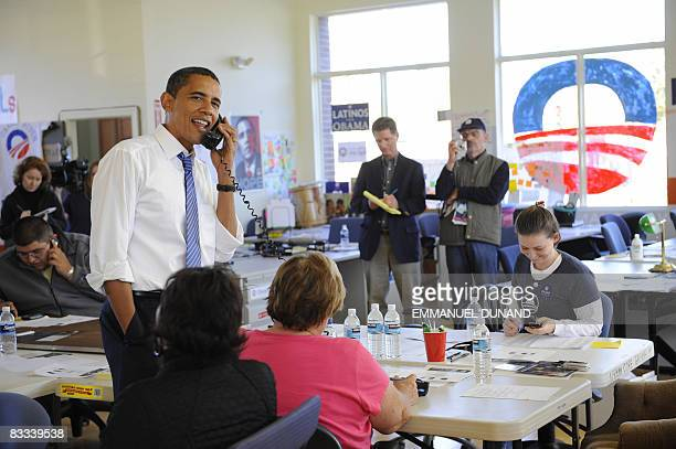 US Democratic presidential candidate Illinois Senator Barack Obama helps volounteers making phone calls to gather votes as he visits the Kansas City...