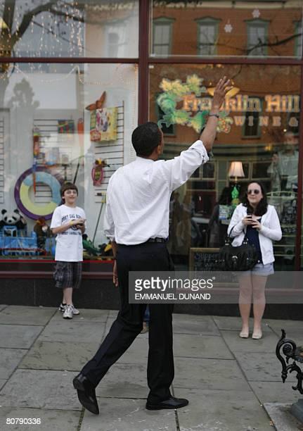 US Democratic presidential candidate Illinois Senator Barack Obama greets residents while walking around Bethlehem Pennsylvania on April 20 2008...