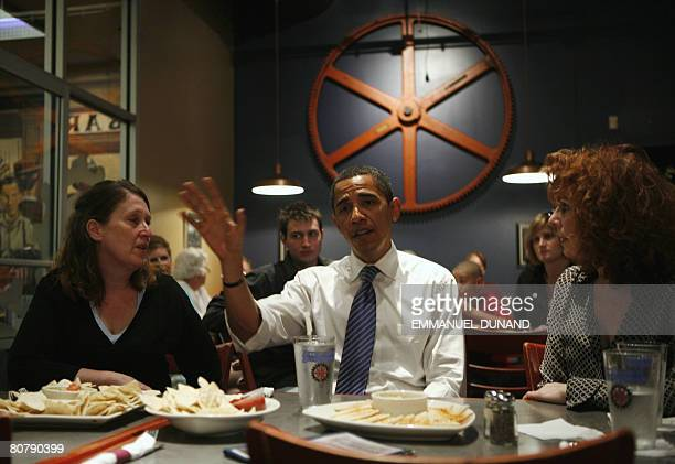 US Democratic presidential candidate Illinois Senator Barack Obama talks with local residents Cheryl Bauer and brewery owner Peg Fegley during a...