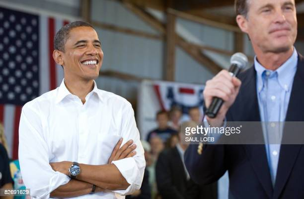 US Democratic presidential candidate Illinois Senator Barack Obama listens to his introduction by Indiana Senator Evan Bayh during a town hall...