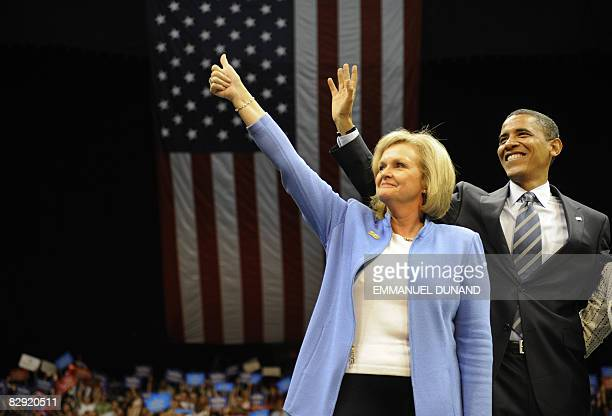US Democratic presidential candidate Illinois Senator Barack Obama waves with Senator Claire McCaskill during a 'Women's Rally For The Change We...