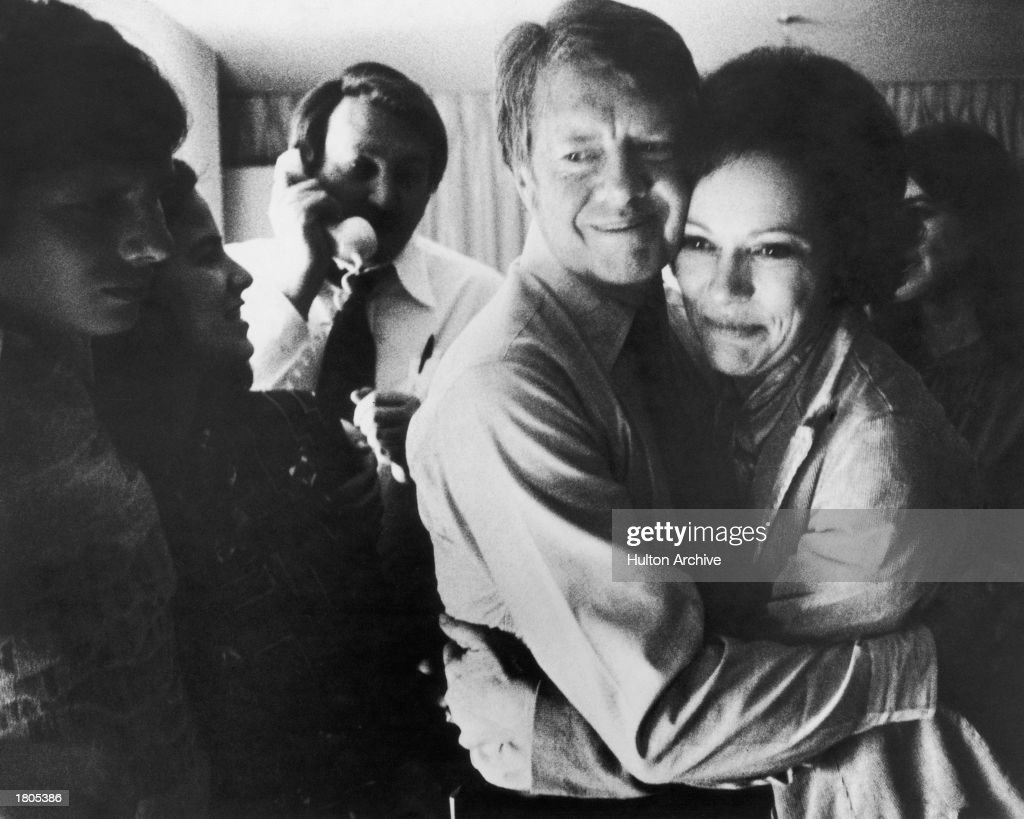 Democratic presidential candidate Jimmy Carter embraces his wife Rosalynn after receiving the final news of his victory in the national general...