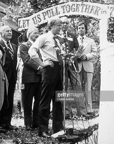 Democratic presidential candidate Jimmy Carter speaks on stage with a 'Let Us Pull Together' banner during his national campaign 1976