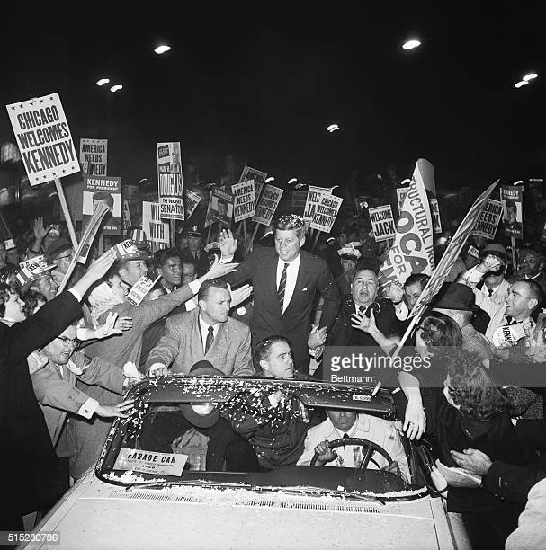 Democratic presidential candidate John F Kennedy campaigns with Chicago mayor Richard J Daley as a crowd of supporters swarms around his motorcade