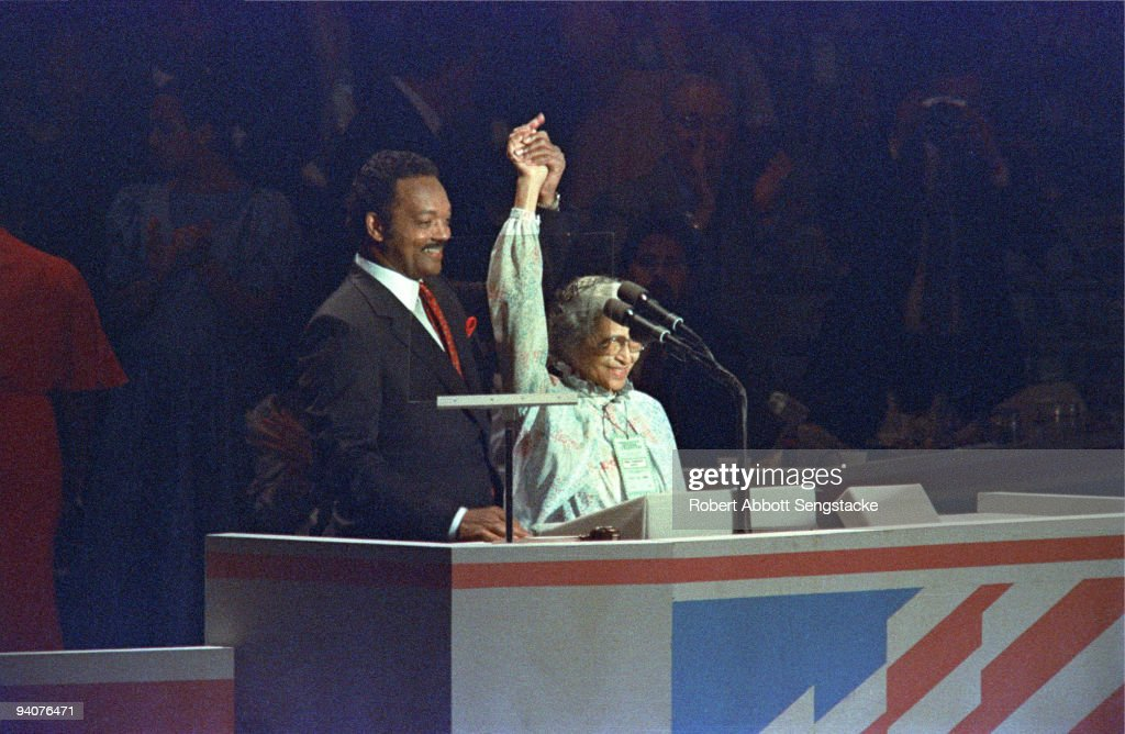 Democratic presidential candidate Reverend Jesse Jackson raising linked hands with civil rights pioneer <a gi-track='captionPersonalityLinkClicked' href=/galleries/search?phrase=Rosa+Parks&family=editorial&specificpeople=169679 ng-click='$event.stopPropagation()'>Rosa Parks</a> (1913 - 2005) during the Democratic National Convention in Atlanta, 1988.