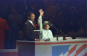 Democratic presidential candidate Reverend Jesse Jackson raising linked hands with civil rights pioneer Rosa Parks during the Democratic National...