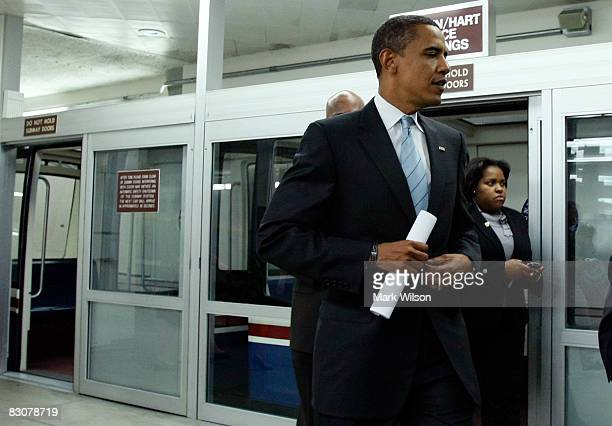 Democratic presidential candidate Sen Barack Obama gets off the subway inside the USCapitol October 1 2008 in Washington DC The US Senate will vote...