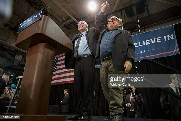 Democratic presidential candidate Sen Bernie Sanders and actor Danny DeVito greet supporters at a campaign rally on March 13 2016 in St Louis...