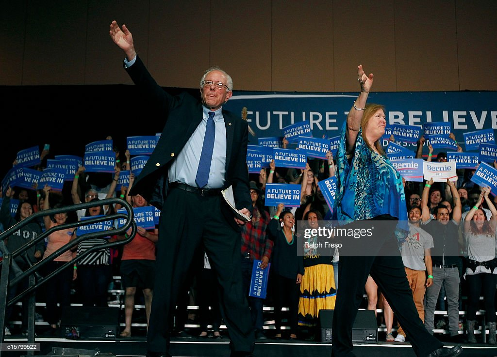 Democratic presidential candidate Sen. Bernie Sanders (D-VT) and his wife Jane wave to the crowd at the Phoenix Convention Center during a campaign rally on March 15, 2016 in Phoenix, Arizona. Hillary Clinton won the Democratic primary elections in Florida, North Carolina and Ohio, while Missouri and Illinois remain tight races