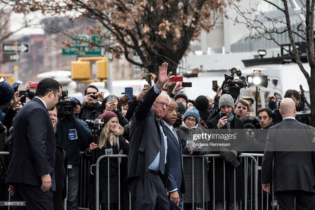 Democratic presidential candidate Sen. Bernie Sanders (D-VT) and Reverend Al Sharpton leave Sylvia's Restaurant after a meeting on February 10, 2016 in the Harlem neighborhood of New York City. The meeting comes after a strong victory for Senator Sanders in the New Hampshire primary.