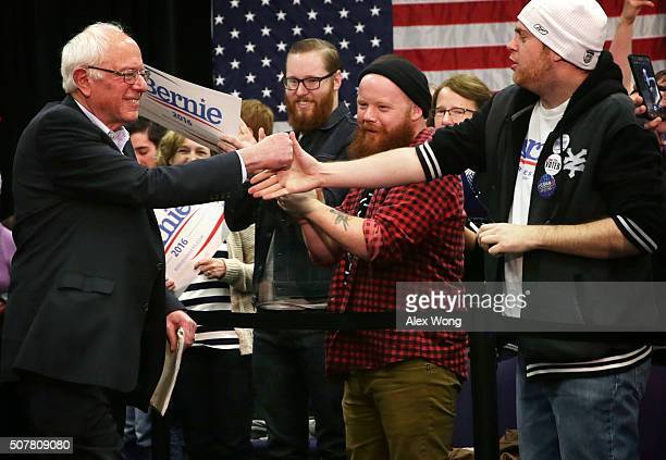 Democratic presidential candidate Sen Bernie Sanders greets supporters as he arrives at a campaign event at Five Sullivan Brothers Convention Center...