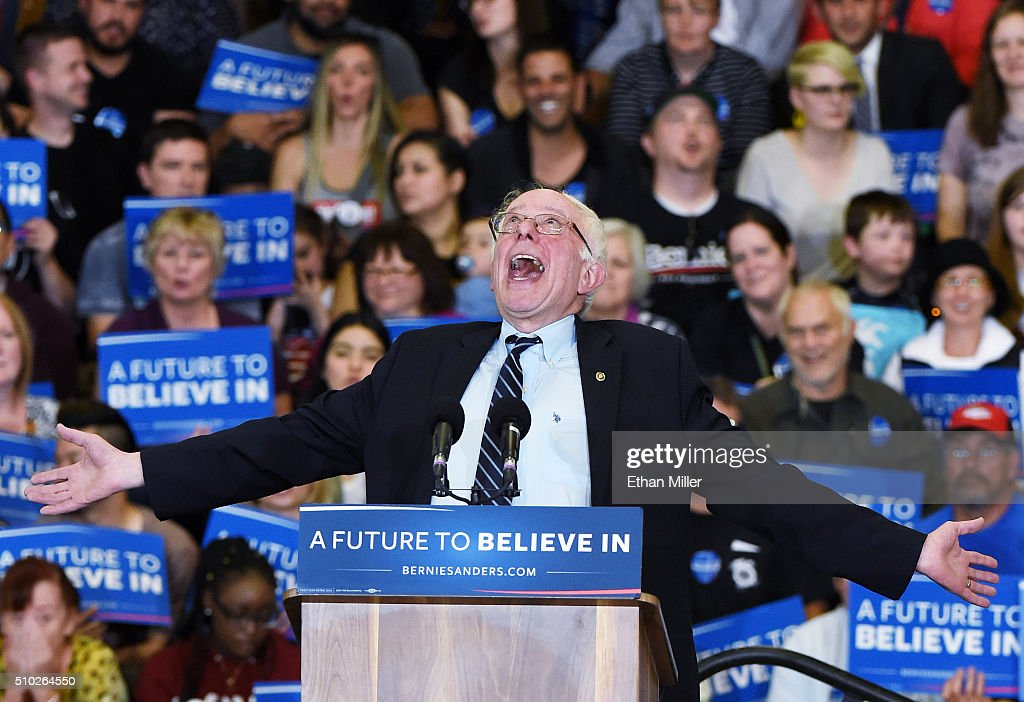 Democratic presidential candidate Sen. <a gi-track='captionPersonalityLinkClicked' href=/galleries/search?phrase=Bernie+Sanders&family=editorial&specificpeople=2908340 ng-click='$event.stopPropagation()'>Bernie Sanders</a> (D-VT) jokes around as he speaks during a campaign rally at Bonanza High School on February 14, 2016 in Las Vegas, Nevada. Sanders is challenging Hillary Clinton for the Democratic presidential nomination ahead of Nevada's February 20th Democratic caucus.
