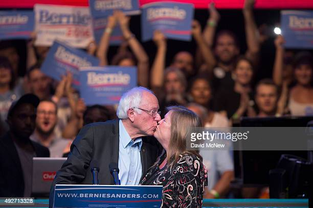 Democratic presidential candidate Sen Bernie Sanders kisses his wife Dr Jane O'Meara Sanders at a campaign fundraising reception at the Avalon...