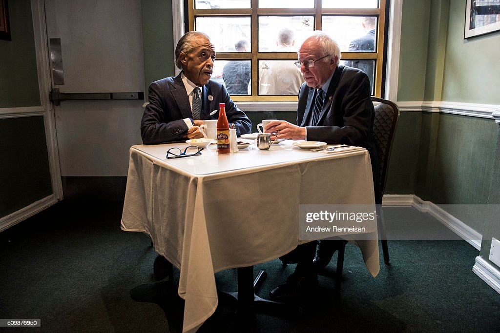 Democratic presidential candidate Sen. <a gi-track='captionPersonalityLinkClicked' href=/galleries/search?phrase=Bernie+Sanders&family=editorial&specificpeople=2908340 ng-click='$event.stopPropagation()'>Bernie Sanders</a> (D-VT) meets with Reverend <a gi-track='captionPersonalityLinkClicked' href=/galleries/search?phrase=Al+Sharpton&family=editorial&specificpeople=202250 ng-click='$event.stopPropagation()'>Al Sharpton</a> at Sylvia's Restaurant on February 10, 2016 in the Harlem neighborhood of New York City. The meeting comes after a strong victory for Senator Sanders in the New Hampshire primary.