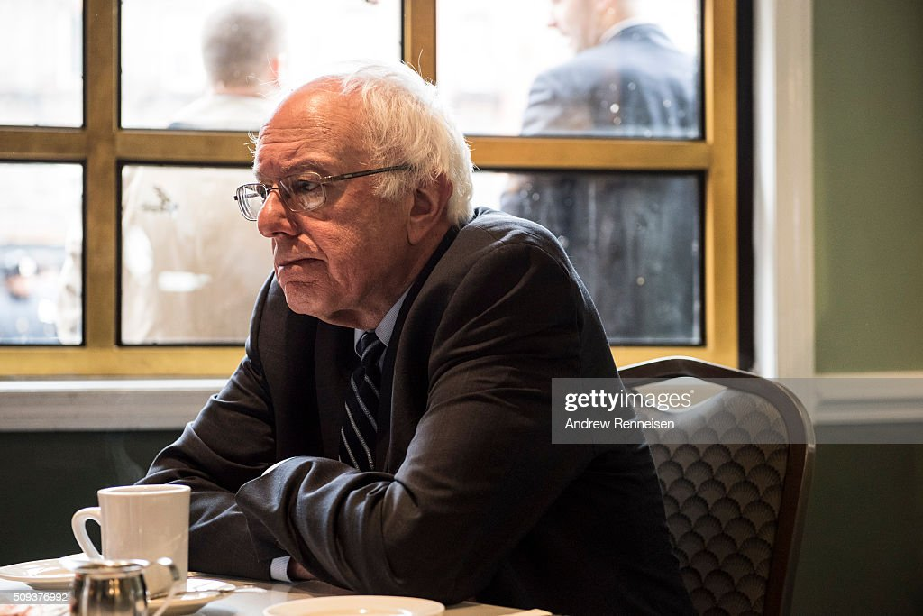 Democratic presidential candidate Sen. <a gi-track='captionPersonalityLinkClicked' href=/galleries/search?phrase=Bernie+Sanders&family=editorial&specificpeople=2908340 ng-click='$event.stopPropagation()'>Bernie Sanders</a> (D-VT) meets with Reverend Al Sharpton at Sylvia's Restaurant on February 10, 2016 in the Harlem neighborhood of New York City. The meeting comes after a strong victory for Senator Sanders in the New Hampshire primary.
