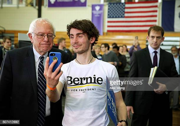 Democratic presidential candidate Sen Bernie Sanders poses for selfie with a voter during a town hall style meeting at Iowa Wesleyan University...