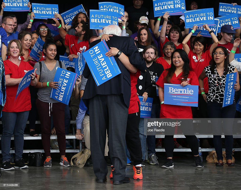 Democratic presidential candidate Sen Bernie Sanders receives a hug after speaking at his caucus watch party at the Henderson Pavilion on February 20...