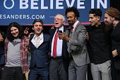Democratic presidential candidate Sen Bernie Sanders sings along with a group of musicians as he attends a Future to Believe in concert and rally at...