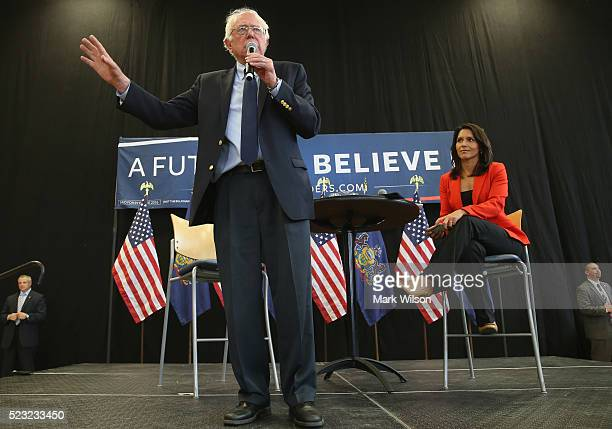 Democratic presidential candidate Sen Bernie Sanders speaks while flanked by RepTulsi Gabbard during a campaign stop at the Bream Wright Hauser...