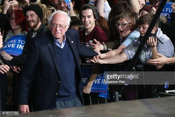Democratic presidential candidate Sen Bernie Sanders walks onstage to greet supporters after winning the Vermont primary on Super Tuesday on March 1...